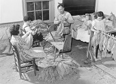 view The Titus Oakley family stripping, tying, and grading tobacco in their bedroom. Granville, County, North Carolina digital asset number 1