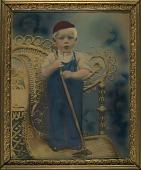 view Boy Standing on Wicker Chair digital asset number 1