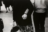 view Untitled [man holding woman's hand behind her back] digital asset number 1