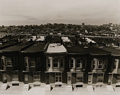 view View of East Baltimore looking west. Brick row houses and white marble steps symbolize these working neighborhoods. White marble steps represented a note of elegance and a mark of respectability to newly arriving European immigrants. Keeping them clean became an art. digital asset number 1