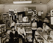view Doris and James Williams in their Butchers Hill grocery store. Friends and neighbors stop by each morning for coffee and to catch up on the news. digital asset number 1