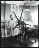view Joseph Pennell at work in his studio at Aldephi Terrace, London [photograph] / (photographed by Peter A. Juley & Son) digital asset number 1