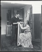 view Henry Strater in his studio with unidentified woman [photograph] / (photographed by Peter A. Juley & Son) digital asset number 1