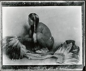 view Mending the War Bonnet [painting] / (photographed by Peter A. Juley & Son) digital asset number 1