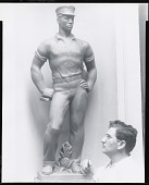 "view Louis Slobodkin standing beside model for ""Hawaiian Postman"" [photograph] / (photographed by Peter A. Juley & Son) digital asset number 1"