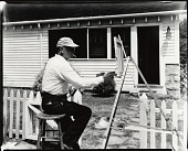 view Joe Miller at work outdoors [photograph] / (photographed by Peter A. Juley & Son) digital asset number 1