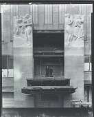 """view Leo Friedlander with unidentified boy standing below """"Television"""" at the RCA Building, Rockefeller Center, New York [photograph] / (photographed by Peter A. Juley & Son) digital asset number 1"""