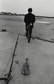 "view Nam June Paik performing ""Violin with String"" (1961) at the Twelfth Annual New York Avant Garde Festival, Floyd Bennett Field, New York, September 27, 1975 digital asset number 1"