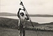 view Running Fence, Sonoma and Marin Counties, California, 1972-76, Cranking tight a lateral guy wire to anchor digital asset number 1