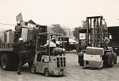 view Running Fence, Sonoma and Marin Counties, California, 1972-76, Fork lifts load trucks with boxes of fabric panels digital asset number 1