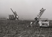 view Running Fence, Sonoma and Marin Counties, California, 1972-76, Anchor drivers securing the last 250 anchors next to ocean digital asset number 1