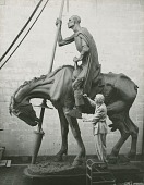 "view Anna Hyatt Huntington working on her heroic ""Don Quixote"" equestrian statue [photograph] / (photographed by Joli Photographers) digital asset number 1"