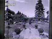 """view [Baymeath]: pool with sculpture """"Wildflower,"""" topiaries, lawn and perennial beds. digital asset: [Baymeath]: pool with sculpture """"Wildflower,"""" topiaries, lawn and perennial beds.: [1920?]"""