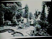 view [Naumkeag]: Mabel Choate in the Afternoon Garden, with Frederick MacMonnies' statue, Young Faun with Heron, in the background. digital asset: [Naumkeag]: Mabel Choate in the Afternoon Garden, with Frederick MacMonnies' statue, Young Faun with Heron, in the background.: 1947