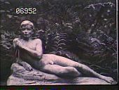 view [The Chimneys]: sculpture of a nude reclining, and holding a musical instrament before a garden of ferns. digital asset: [The Chimneys]: sculpture of a nude reclining, and holding a musical instrament before a garden of ferns.: [1910?]