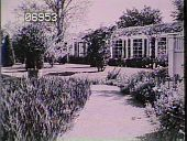 view [The Chimneys]: walkway with garden boarders, entering into a side yard with angled view of pergola. digital asset: [The Chimneys]: walkway with garden boarders, entering into a side yard with angled view of pergola.: [1930?]