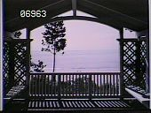 view [The Chimneys]: view from under gazebo type structure overlooking the beach. digital asset: [The Chimneys]: view from under gazebo type structure overlooking the beach.: [1910?]