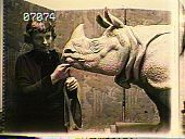 view [The Chimneys]: Katharine Lane Weems with her sculpture of a rhinoceros. digital asset: [The Chimneys] [slide (photograph)]: Katharine Lane Weems with her sculpture of a rhinoceros.