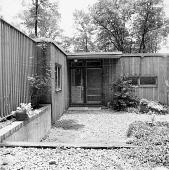 view [Coffey Garden]: doorway and surrounding plantings. digital asset: [Coffey Garden] [contact print]: doorway and surrounding plantings.