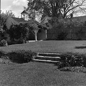 view [Unidentified Garden in Unknown Location]: looking up stairs across lawn to house. digital asset: [Unidentified Garden in Unknown Location] [safety film negative]: looking up stairs across lawn to house.