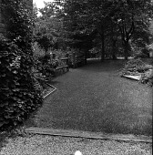 view [Unidentified Garden in Unknown Location]: lawn area, with garden area in far left. digital asset: [Unidentified Garden in Unknown Location] [contact print]: lawn area, with garden area in far left.