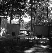 view [Unidentified Garden in Unknown Location]: view across patio toward pond. digital asset: [Unidentified Garden in Unknown Location] [contact print]: view across patio toward pond.