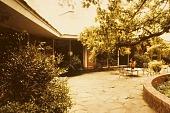 view [Dunklin Garden 1955-1987]: flagstone terrace and house. digital asset: [Dunklin Garden 1955-1987]: flagstone terrace and house.: 1982 Jun.