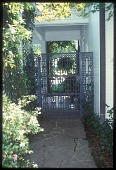 view [Bellingrath Longmeadow Garden]: one of two ornate wrought iron gates, in the New Orleans style. digital asset: [Bellingrath Longmeadow Garden]: one of two ornate wrought iron gates, in the New Orleans style.: 2009 Jul.