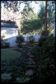 view [Bellingrath Longmeadow Garden]: a stepping stone path leads from the terrace to the cabana. digital asset: [Bellingrath Longmeadow Garden]: a stepping stone path leads from the terrace to the cabana.: 2009 Jul.