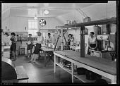 view Women washing dishes in farmhouse kitchen digital asset: Women washing dishes in farmhouse kitchen