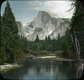 view Yosemite National Park: a view of Half Dome from the Yosemite Valley, solid granite rock rising to a height of nearly one mile. digital asset: Yosemite National Park: a view of Half Dome from the Yosemite Valley, solid granite rock rising to a height of nearly one mile.: [between 1914 and 1949?]