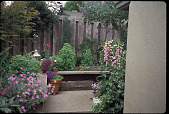 view [Micro Casa]: flower bed as walk turns corner. digital asset: [Micro Casa]: flower bed as walk turns corner.: 2000 Jun.