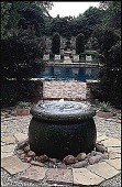 view [Volk Garden]: a fountain, looking toward the swimming pool. digital asset: [Volk Garden]: a fountain, looking toward the swimming pool.: 1999 Apr.