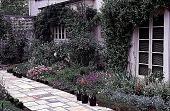 view [Volk Garden]: plantings on the courtyard side of the house. digital asset: [Volk Garden]: plantings on the courtyard side of the house.: 1999 Apr.
