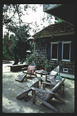 view [Untitled garden in Pasadena, California]: rear terrace with Adirondack chairs. digital asset: [Untitled garden in Pasadena, California] [slide]: rear terrace with Adirondack chairs.