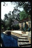 view [Untitled Garden in Pasadena, California]: curving step adjacent to pool edge. digital asset: [Untitled Garden in Pasadena, California] [slide]: curving step adjacent to pool edge.