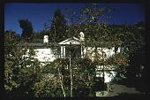 view Robert M. Fletcher slide collection digital asset: [Untitled Garden in Bel Air, California] [slide]: view of house across hillside.