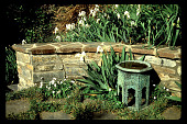 view [Untitled Garden in Bel Air, California]: antique metal seat adjacent to bouquet canyon stone seat wall. digital asset: [Untitled Garden in Bel Air, California] [slide]: antique metal seat adjacent to bouquet canyon stone seat wall.