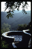 view [Untitled Garden in Bel Air, California]: bouquet canyon stone viewing area at top of hillside overlooking mountain. digital asset: [Untitled Garden in Bel Air, California] [slide]: bouquet canyon stone viewing area at top of hillside overlooking mountain.