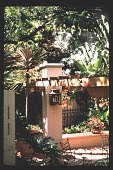 view [Untitled Garden in Hollywood, California]: corner of pergola with outdoor lighting. digital asset: [Untitled Garden in Hollywood, California] [slide]: corner of pergola with outdoor lighting.