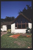 view [Thompson Garden]: front window of house with stained glass panel in heather below. digital asset: [Thompson Garden]: front window of house with stained glass panel in heather below.: 1996 Aug.