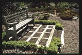 view [Thompson Garden]: bench and terrace made from wood (inside of terrace squares constructed of shingles pounded on end into the ground). digital asset: [Thompson Garden]: bench and terrace made from wood (inside of terrace squares constructed of shingles pounded on end into the ground).: 1991 Jun.