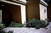 view [Untitled Garden, Pebble Beach, California]: a view of the entry, showing a Laguan-Thai figure on the wall. digital asset: [Untitled Garden, Pebble Beach, California]: a view of the entry, showing a Laguan-Thai figure on the wall.: 1999 Apr.