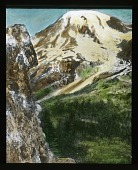 view [Canadian Rockies]: an unidentified snow-capped mountain and the valley below. digital asset: [Canadian Rockies]: an unidentified snow-capped mountain and the valley below.: [between 1915 and 1930]