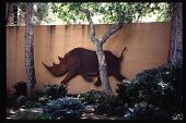 view [El Mardon]: rhino sculpture on entrance driveway stucco wall. digital asset: [El Mardon]: rhino sculpture on entrance driveway stucco wall.: 1997 Aug.