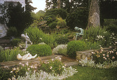 view [Baylis Garden]: sculpture garden surrounded by stone and brick walls with small perennial shrubs and box. digital asset: [Baylis Garden]: sculpture garden surrounded by stone and brick walls with small perennial shrubs and box.: 2005.