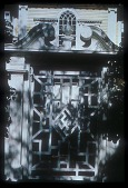 view [Oldgate]: close up of overthrow; gates; Sanskrit symbol for well being appears on gate as architectural detail. digital asset: [Oldgate]: close up of overthrow; gates; Sanskrit symbol for well being appears on gate as architectural detail.: 1900