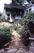 view [The Miller's House]: path to pink and blue border en route to kitchen garden. digital asset: [The Miller's House]: path to pink and blue border en route to kitchen garden.: 1998 Jul.