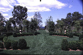 view [Windy Hill]: center of box parterre looking north through gate to the Litchfield Hills. digital asset: [Windy Hill]: center of box parterre looking north through gate to the Litchfield Hills.: 1999 Jul.