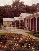 view [Iaccaci Garden]: house, patio, and rose garden. digital asset: [Iaccaci Garden] [film transparency]: house, patio, and rose garden.